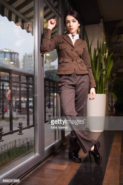 woman in trouser suit looking at camera - brown jacket stock pictures, royalty-free photos & images