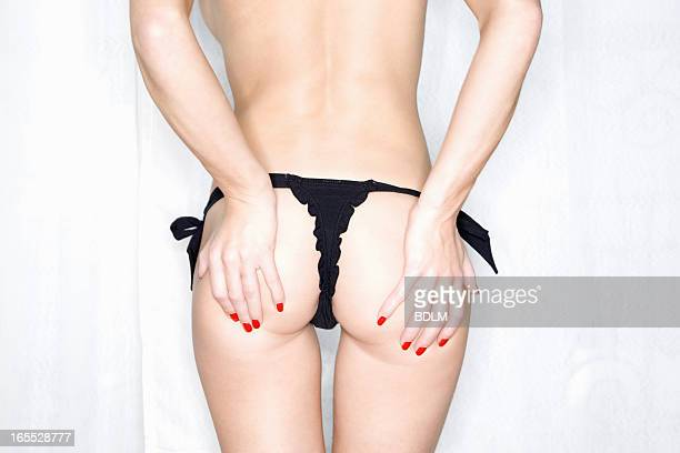 Woman in underwear holding buttocks
