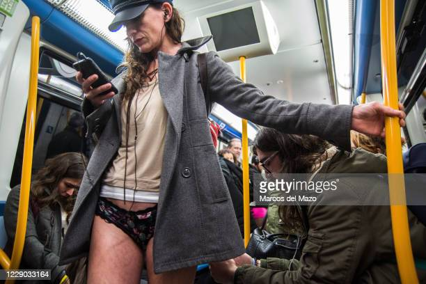 "Woman in underwear inside the metro during the annual ""No Pants Subway Ride""."