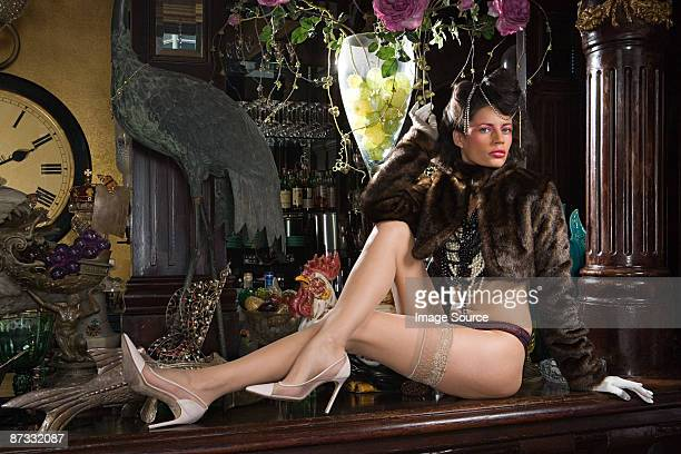 woman in underwear reclining on a bar top - women wearing pantyhose stock photos and pictures