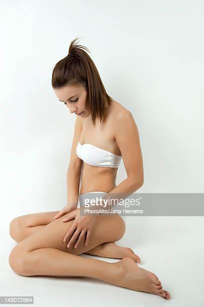 Woman in underwear touching her leg