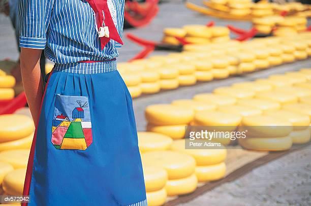 Woman in Uniform Standing in Front of Rows of Cheese, Alkmaar, Netherlands