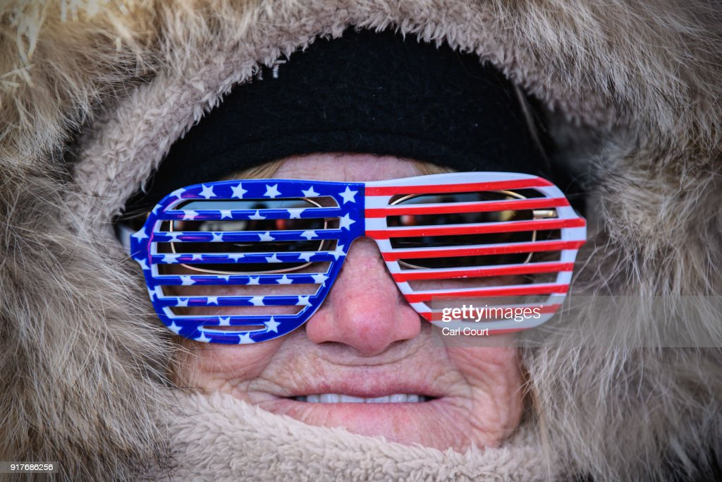 A woman in U.S.A novelty glasses poses for a photograph ahead of the Men's Halfpipe Qualification Run 1 snowboarding competition at Phoenix Park on day four of the PyeongChang Winter Olympics on February 13, 2018 in Pyeongchang-gun, South Korea.