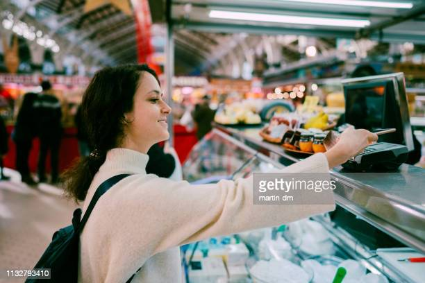 woman in valencia shopping at the farmer's market - nfc stock pictures, royalty-free photos & images