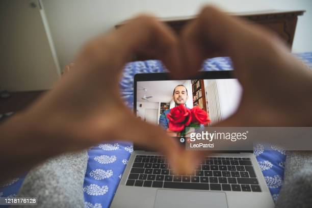 woman in video call with her partner - social relations at covid19 social distancing times - lockdown foto e immagini stock