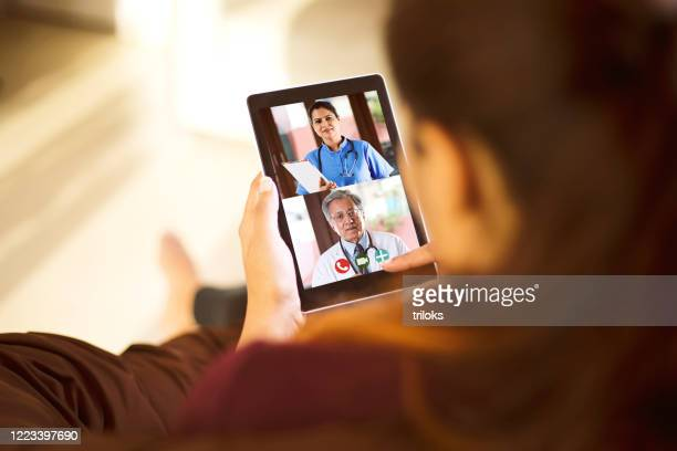 woman in video conference with doctor - remote location stock pictures, royalty-free photos & images
