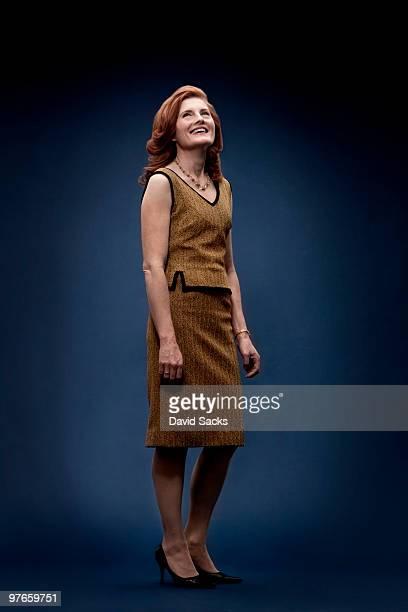 Woman in vintage dress looking up