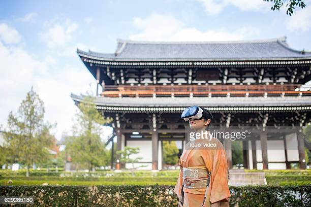 Woman in virtual reality headset surrounded by Japanese scenery