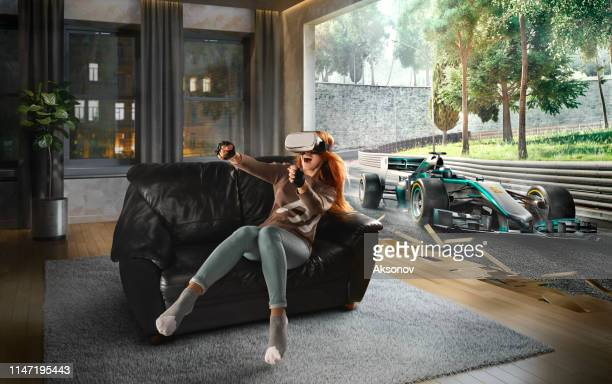 woman in vr glasses. virtual reality with racing cars on the track - car racing stock pictures, royalty-free photos & images