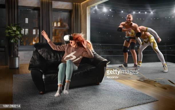 woman in vr glasses. virtual reality with wrestling - wrestling stock pictures, royalty-free photos & images