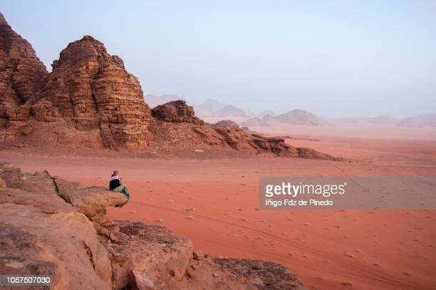 a woman in wadi rum, valley of moon, jordan. - jordan middle east stock pictures, royalty-free photos & images