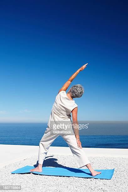 Woman in warrior yoga pose