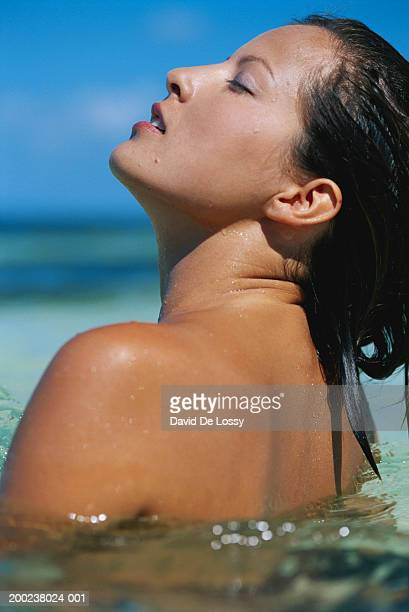 Woman in water at beach