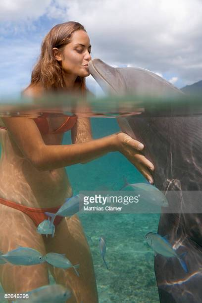 woman in water kissing dolphin - hot women making out stock pictures, royalty-free photos & images