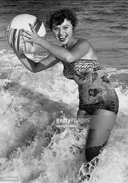 Woman in water with beachball