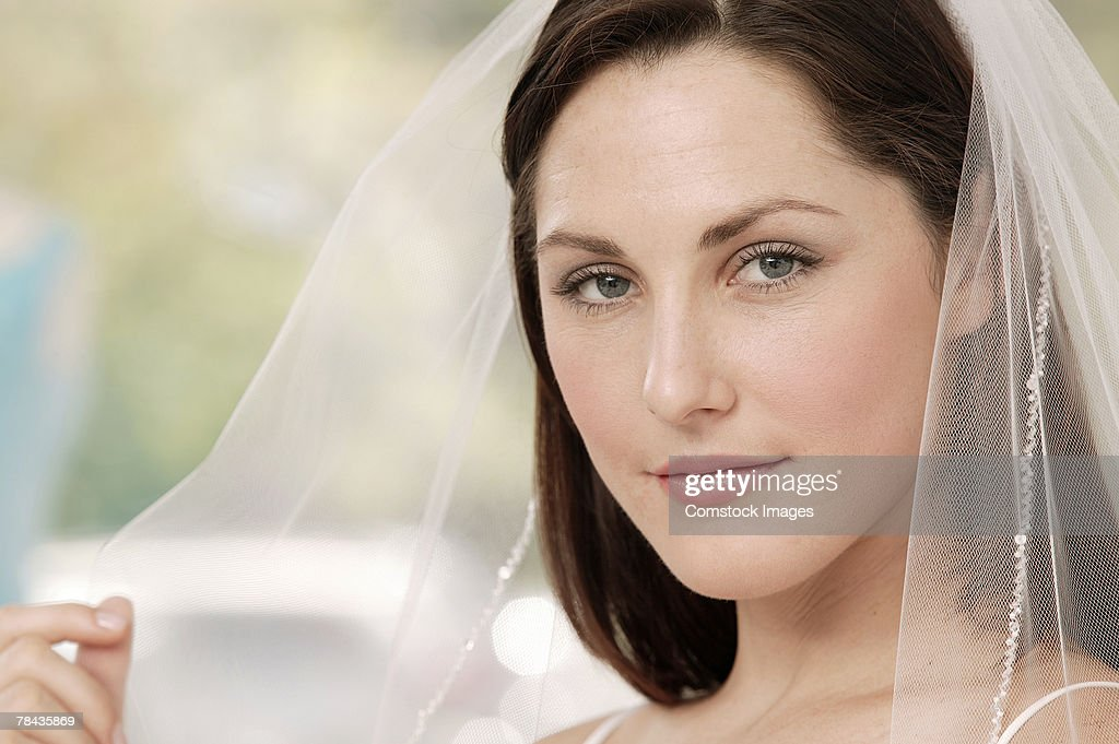 Woman in wedding veil : Stockfoto