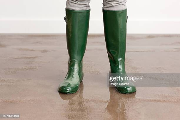 woman in wellington boots on flooded floor - flood stock pictures, royalty-free photos & images