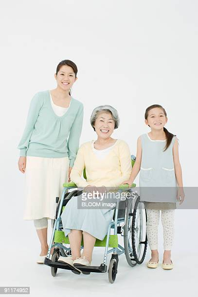 Woman in wheelchair, daughter and granddaughter