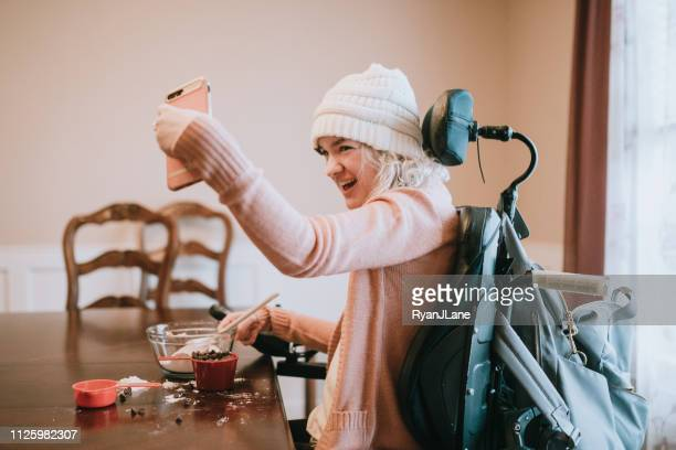 Woman In Wheelchair Takes Selfie Baking Cookies