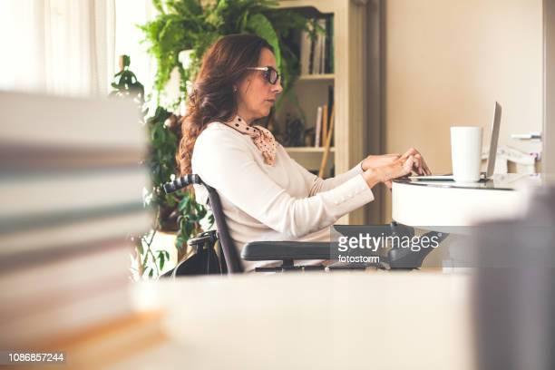 Woman in wheelchair working freelance