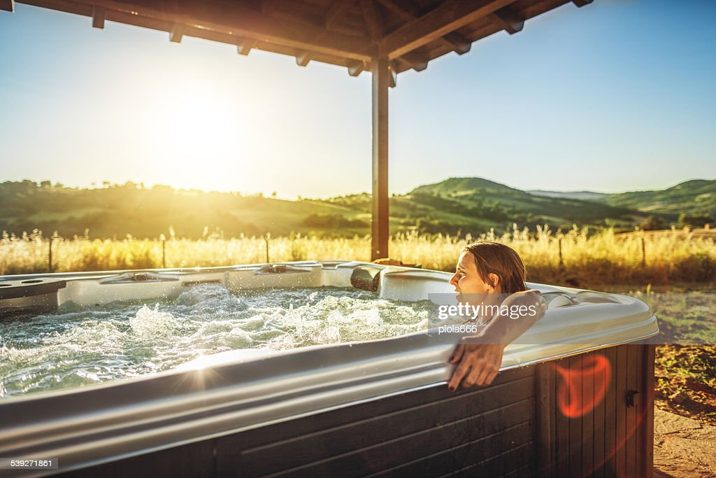 Woman in whirlpool hot tub during spa treatment : Stock Photo