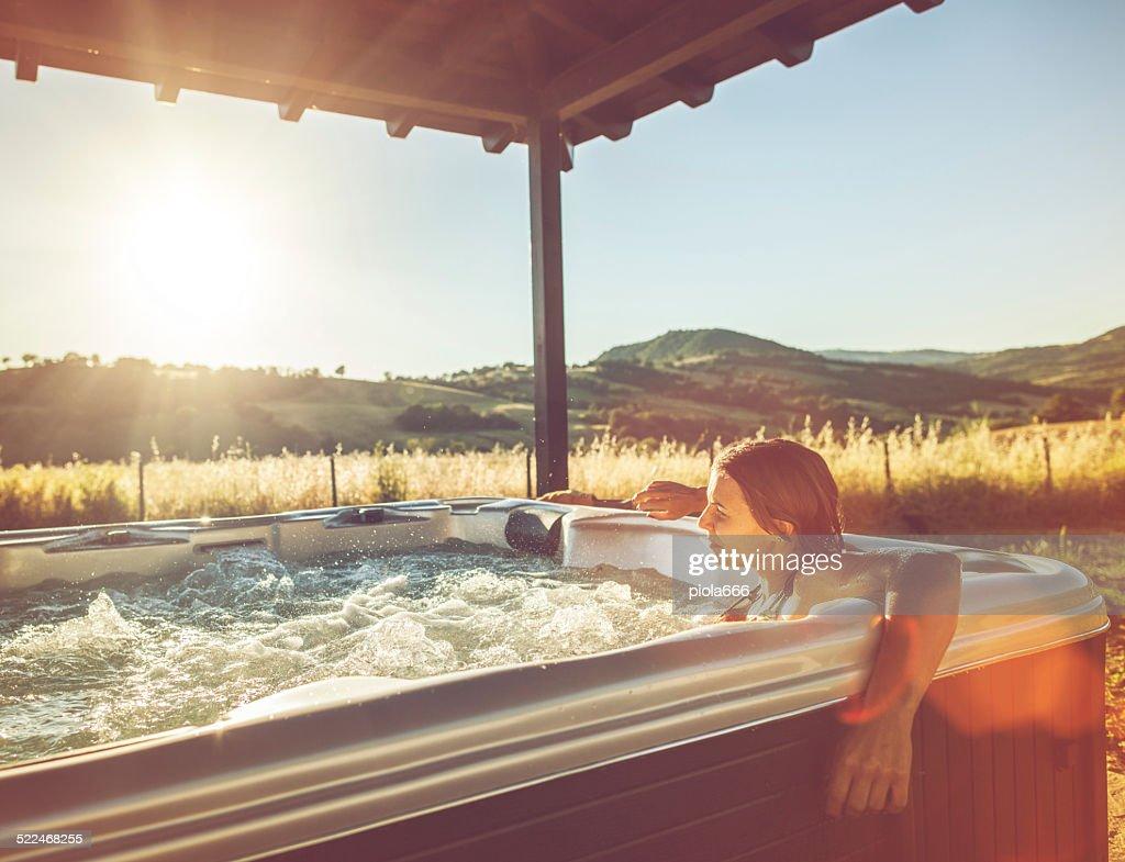 Woman in whirlpool hot tub : Stock Photo