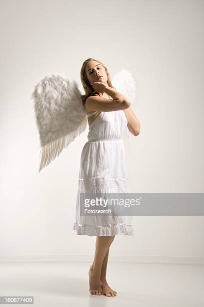 Woman in white angel costume