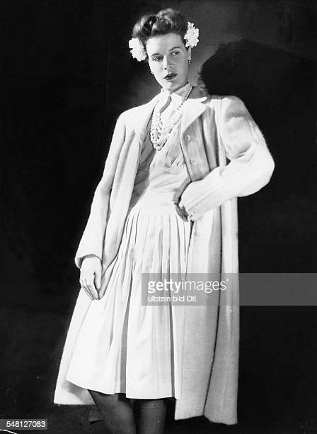 Woman in white dress of raw silk and fleece coat model Horn 1943 Photographer Regine Relang Vintage property of ullstein bild