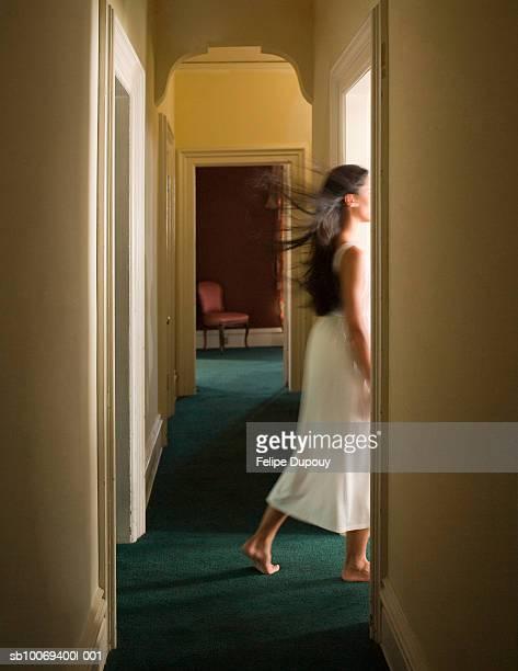 woman in white dress walking through doorway - white dress stock pictures, royalty-free photos & images
