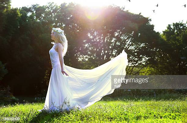 Woman in white in nature