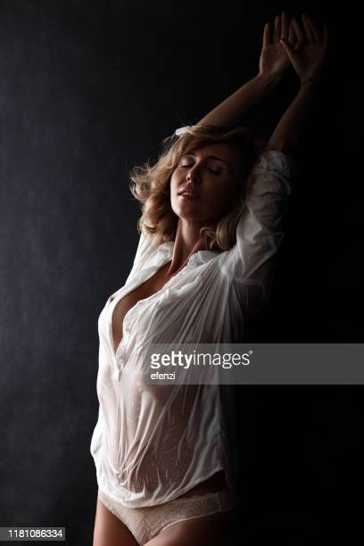 woman in white shirt - wet knickers stock pictures, royalty-free photos & images