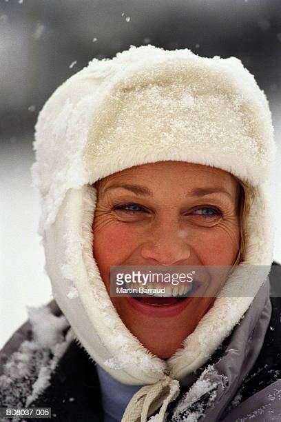 Woman in white winter hat, smiling, close-up