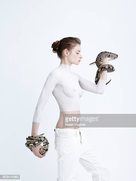 Woman in white with snakes