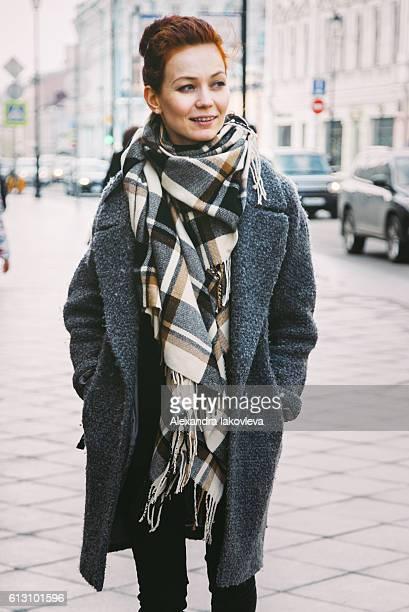 Woman in winter coat on the street