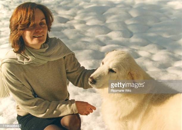 woman in winter with her maremma sheepdog - pastore maremmano foto e immagini stock