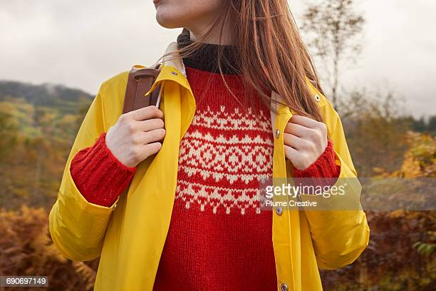 Woman in wooly jumper and rucksack