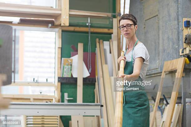 woman in workshop checking alphorn tube - sigrid gombert stock pictures, royalty-free photos & images