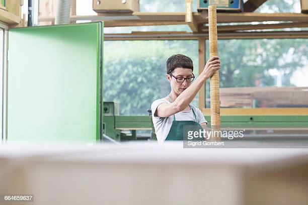 woman in workshop holding alphorn - sigrid gombert stock pictures, royalty-free photos & images