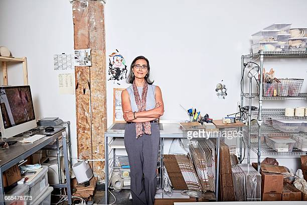 Woman in workshop office looking at camera smiling