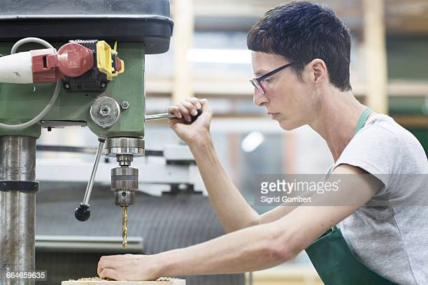 woman in workshop using drilling machinery - sigrid gombert stock pictures, royalty-free photos & images