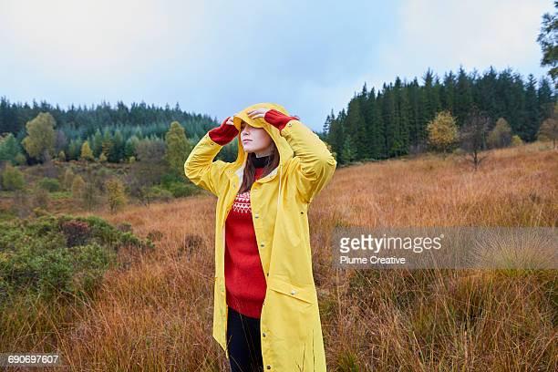 Woman in yellow raincoat