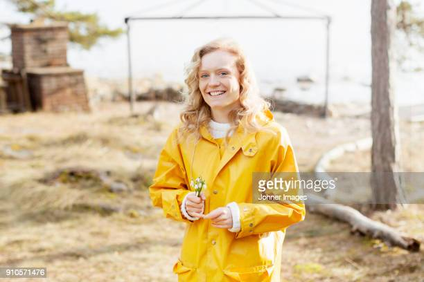 woman in yellow raincoat - snowdrop stock pictures, royalty-free photos & images