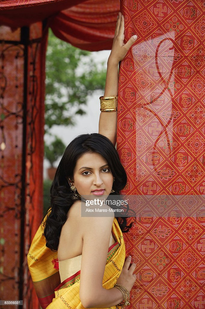 woman in yellow sari, red tent : Stock Photo