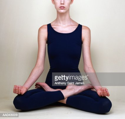 woman in yoga lotus position stock photo  getty images