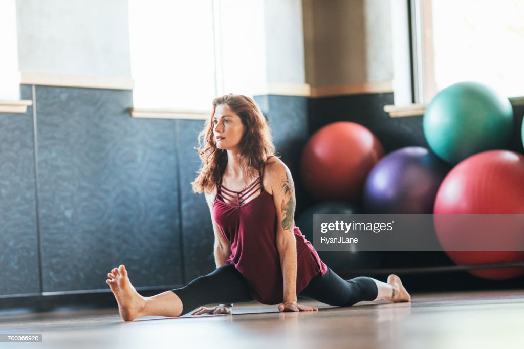Woman In Yoga Poses High Res Stock Photo Getty Images