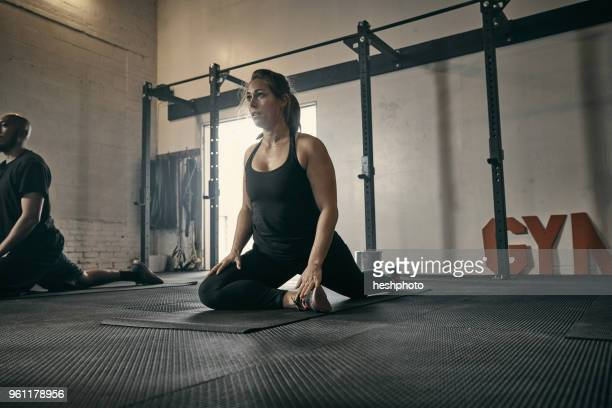 woman in yoga position in gym - heshphoto stock pictures, royalty-free photos & images
