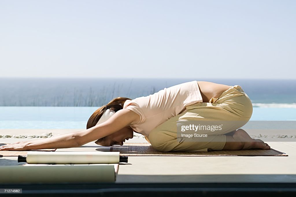 Woman in yoga position : Stock Photo
