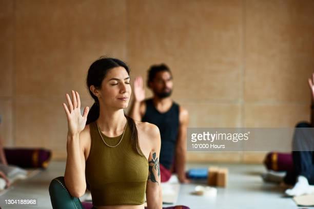 woman in yoga position with eyes closed - limb body part stock pictures, royalty-free photos & images