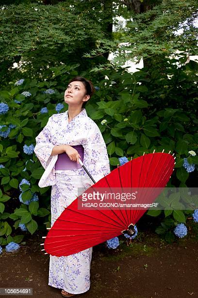 Woman in yukata with paper umbrella, Ibaraki Prefecture, Honshu, Japan