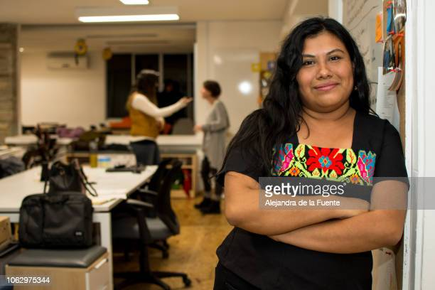 young indigenous woman in the office. - nuevo leon stock pictures, royalty-free photos & images
